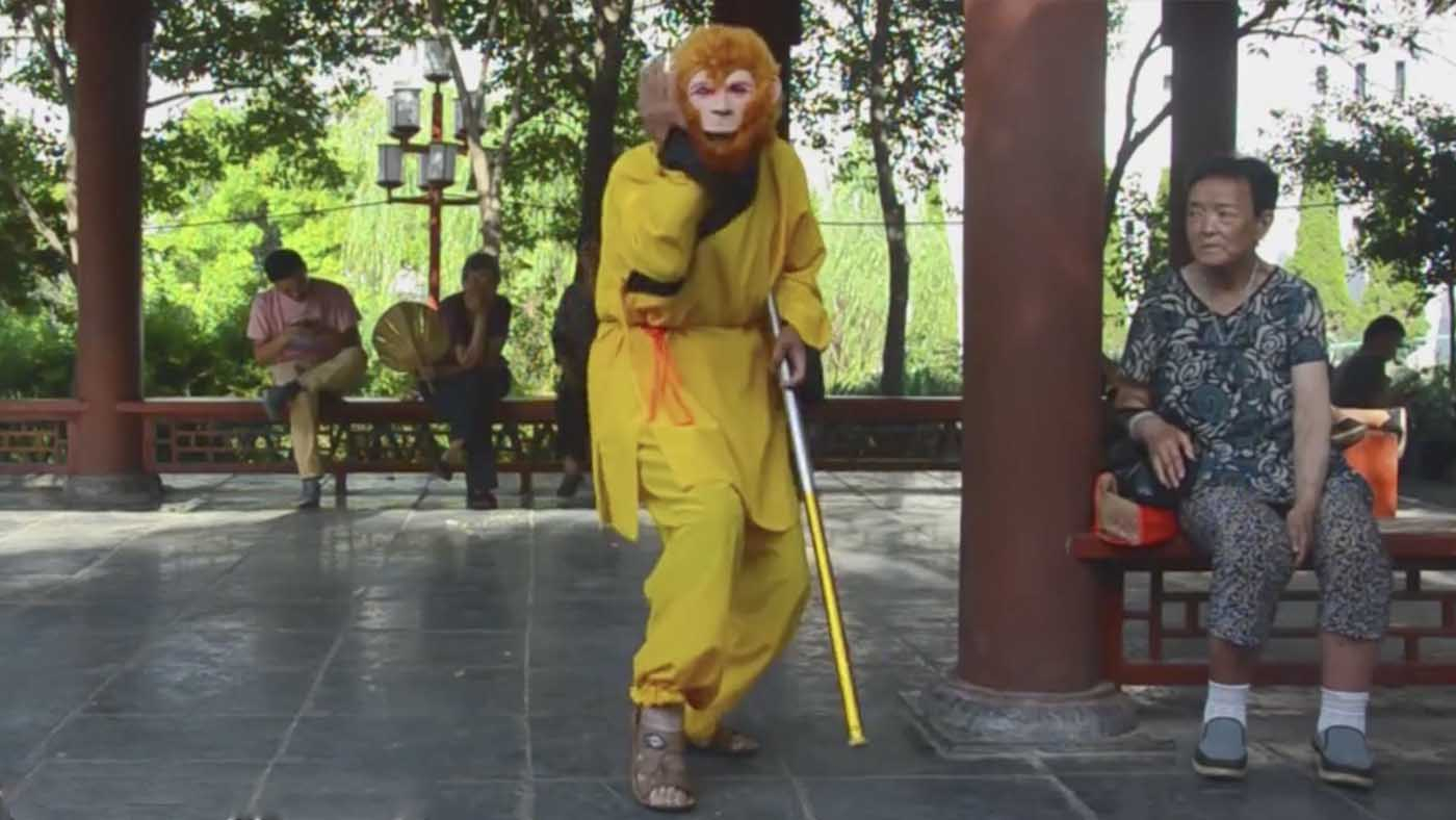 For more than three years, 70-year-old Guan Zhengnan dressed up as